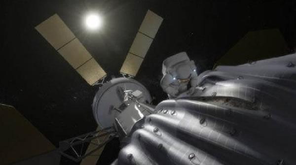 艺术家绘制的捕获小行星情况,NASA的宇航员正在猎户座飞船外作业