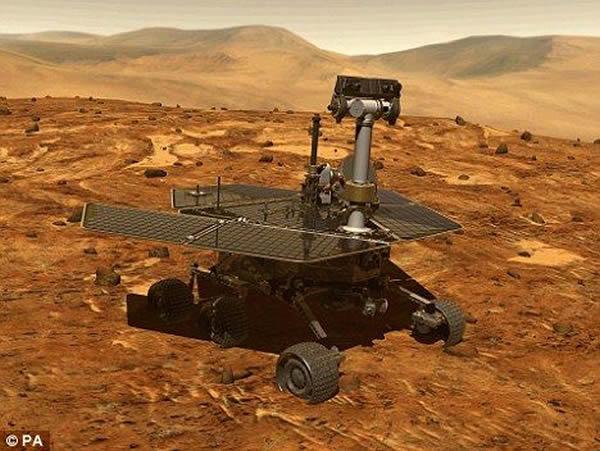 这是一幅电脑合成图像,显示的是勇气号在火星表面行驶时的摸样。