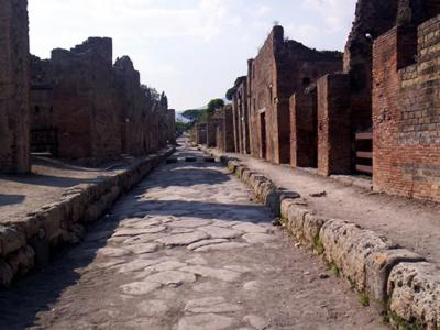 Pompeii Walls Crumble Under Rain and Red Tape