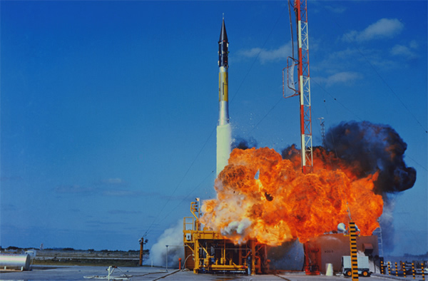 Flame and smoke burst from the Vanguard test vehicle at Cape Canaveral, Florida,