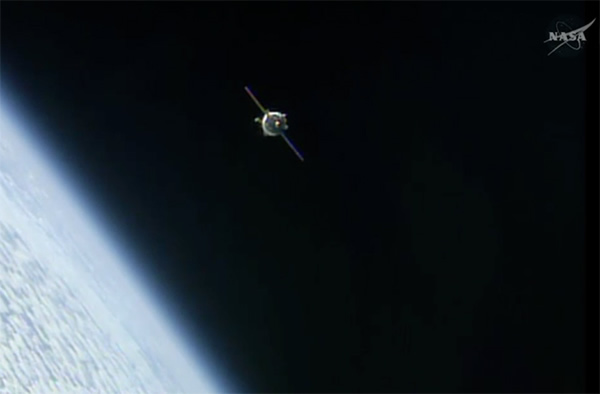 Soyuz capsule nears the space station.