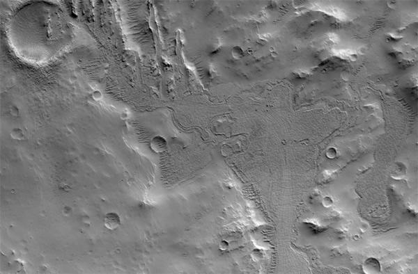 HiRISE image of a distinctive flow deposit southwest of Cerberus Fossae on Mars