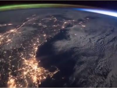只在太空才能见:当日出遇上北极光