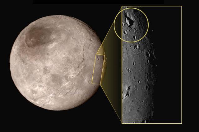 NASA7月17日公布的位于卡戎(Charon)北半球一座位于巨型盆地里的巨大山峰