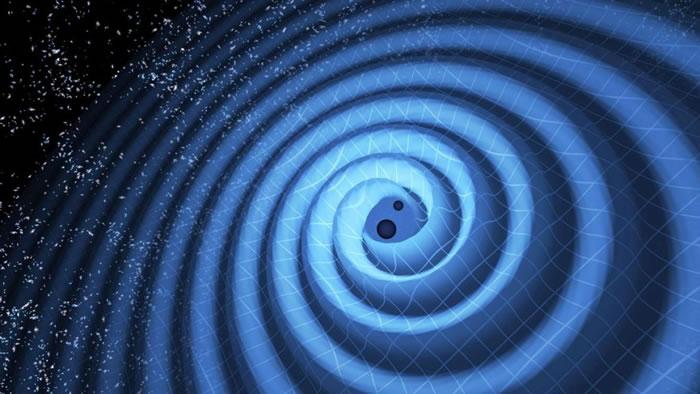 这张图呈现两个黑洞结合的过程。当这两个黑洞边旋转边靠近时,重力波如同涟漪般层层向外扩散。 PHOTOGRAPHY COURTESY LIGO, T. PYLE