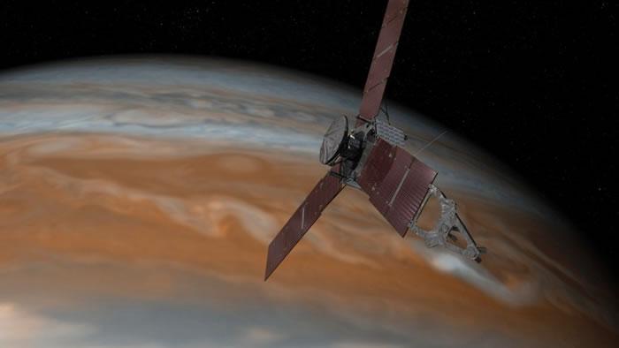 画家笔下朱诺号进入木星轨道情形。