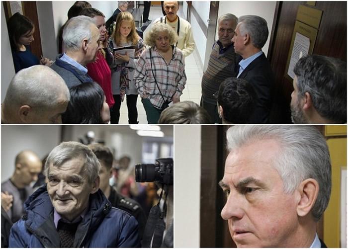 阿努夫里耶夫 (上图右二、右下图)与德来特里耶夫的支持者对话。