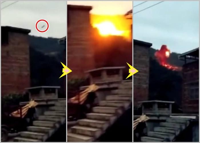 火箭发射残骸从半空急速坠落山头后,发出巨响并冒起巨大火球。