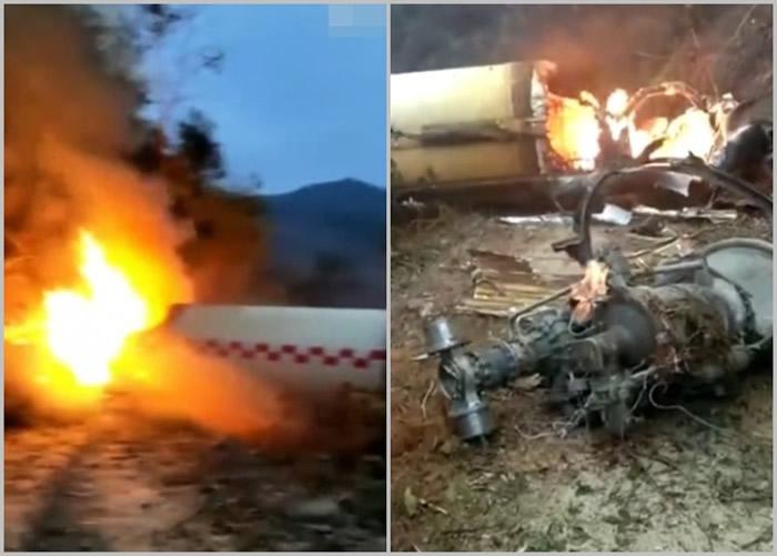 火箭发射残骸坠落后燃烧,机件散落一地。
