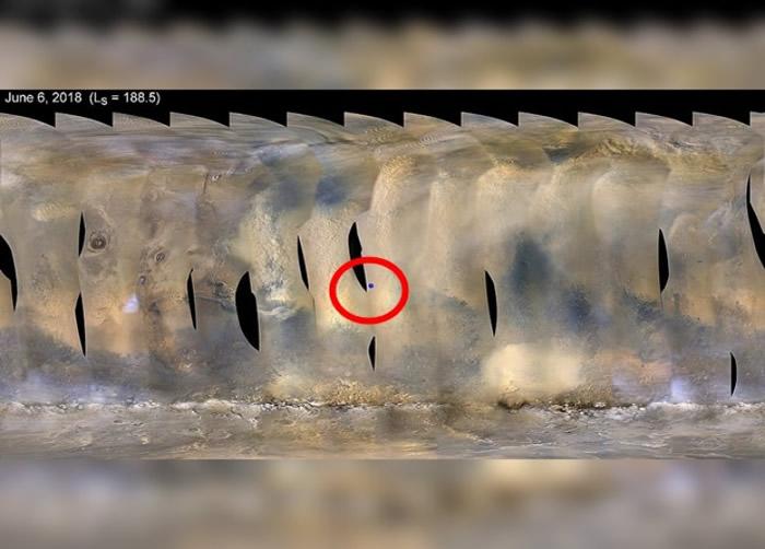 火星受沙尘暴吹袭,红圈为机遇号位置。