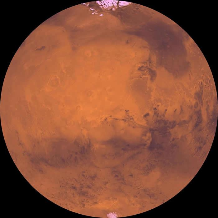 黑暗的盆地和明亮的极冠是火星上相当明显的特征。 PHOTOGRAPH BY NASA, JPL, USGS