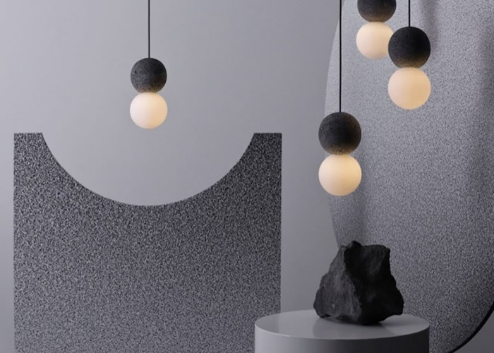 """墨西哥设计公司推出黑斑火山岩结合乳白色玻璃达出和谐美的球形灯饰""""Origo"""""""