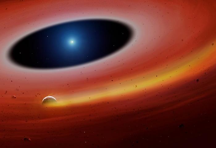 这张艺术家的想象图描绘出新发现的恒星系统,有块行星碎片绕着白矮星公转。 ILLUSTRATION BY UNIVERSITY OF WARWICK/ MARK