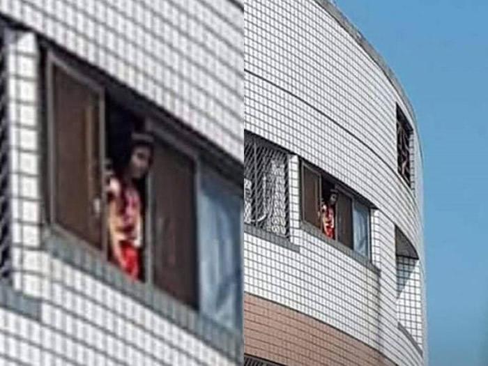 """台湾女子晒衣服惊见对面住宅身穿红衣""""脸色死"""