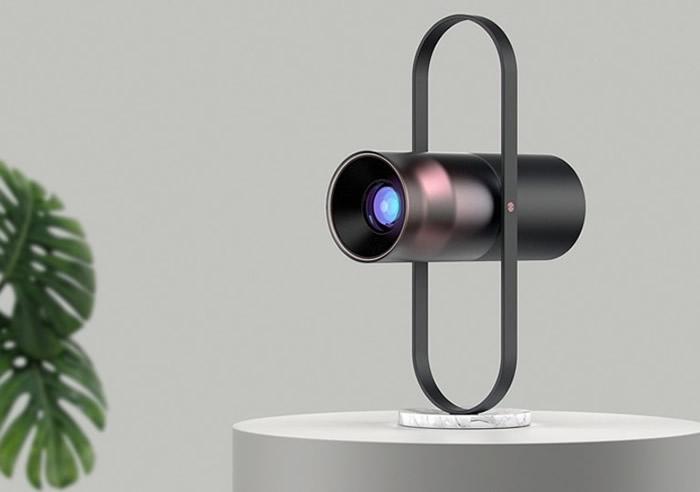 圆柱形投影仪PHOS以抛光金属和磨砂玻璃制成。