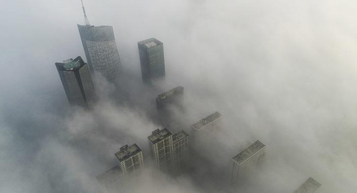 长期停留在空气污染的地方可能会加速肺部疾病 危害和每天吸一包烟相当