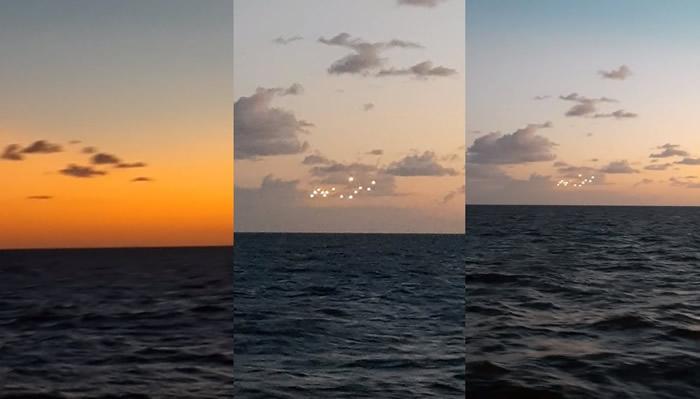 UFO?美国北卡罗莱纳州外海黄昏海面天空出现14个奇异光点