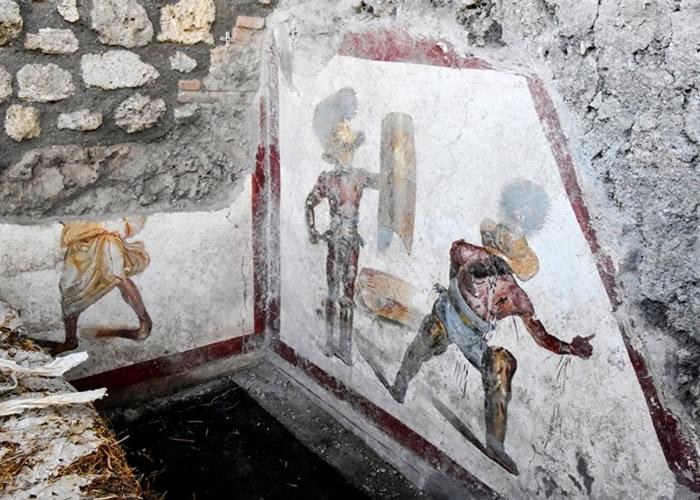 意大利庞贝古城考古公园北部酒室发现绘画角斗士战斗的壁画