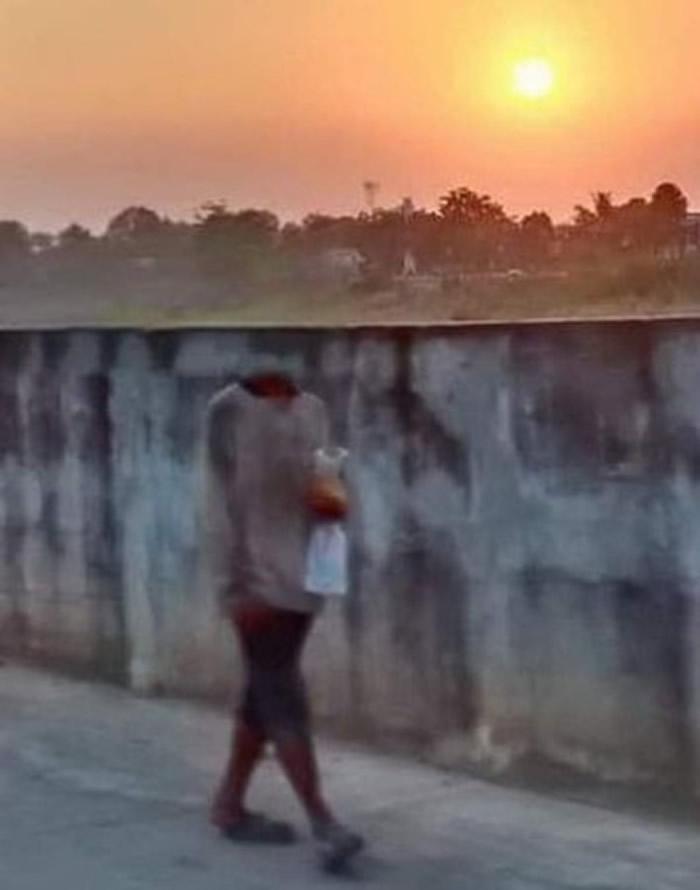 泰国传出灵异照片:日落中的无头行人
