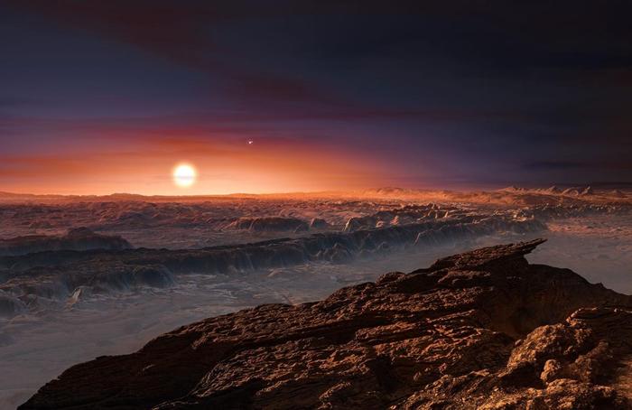 在这张艺术家的想象图中,比邻星所发出的红色光芒笼罩着行星比邻星b的地表。 PHOTO ILLUSTRATION BY ESO, M. KORNMESSER