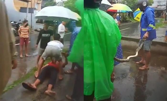 印尼峇厘岛16岁少年突然倒在路上民众以为新冠肺炎患者 原来大蟒蛇缠脖子