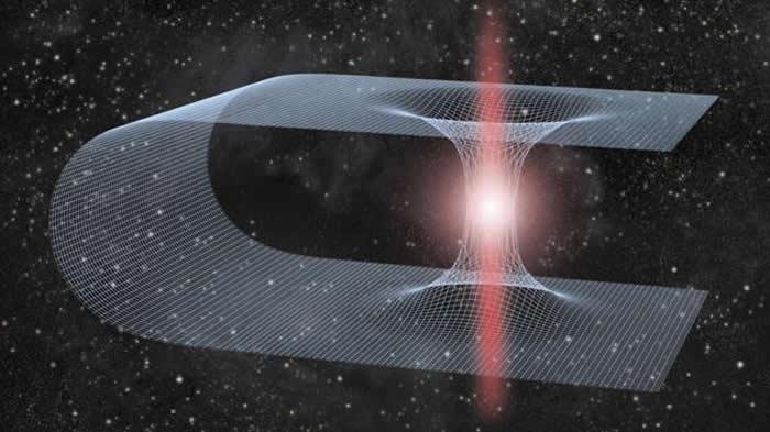 虫洞是穿越时空的隧道,连接着宇宙的不同部分(概念图)。美国物理学家报告称,围绕虫洞旋转的黑洞可能会释放出一种新的引力波模式