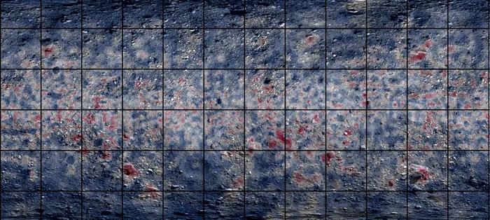 在这幅利用红外光谱技术所绘制出的贝努小行星全球地图上,特别醒目的区域表示富含碳元素,像是有机分子和碳酸盐矿物(红色)。一些巨石上的纹理显示在太阳系形成初期,贝努