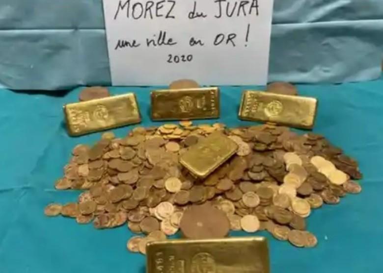法国东部侏罗省莫雷兹镇政府收购旧楼翻修发现大量金条金币